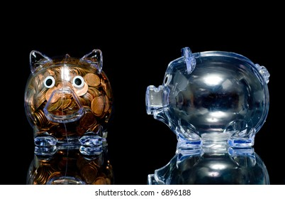 Two clear acryllic piggy banks one stuffed full of american pennies the other empty,.  one pig is jealous the thought bubble can be filled with whatever you like