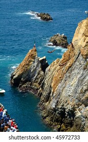 Two cliff divers jumping together