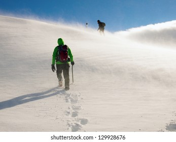 Two climbers ascending a ridge in the Fagaras mountains (Romania) in very high wind conditions