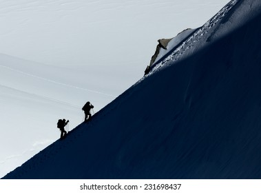 Two climbers on a mountain ridge