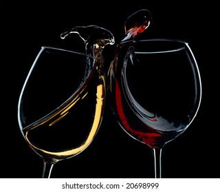 Two clincking glasses with red and white wine. Very high resolution.