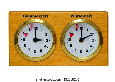 Two clocks in one housing, which are showing the summer- and the standard time. Isolated