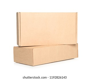 Two closed cardboard boxes on white background
