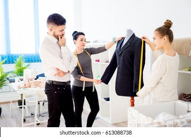 Two clothes designers