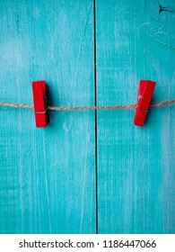 Two clothespins on  rope with wood wall background, Vintage clip, red clothespin