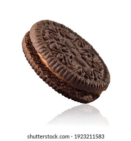 Two cocoa cookies with cocoa filling between on white background