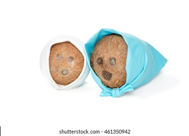 Two coconut lying side by side in a blue and white scarf depicting a man and a woman isolated on white background