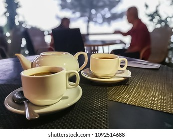 Two cofee cups on wooden background.