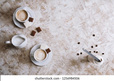 Two coffee cups on a bright vintage background. Top view with copy space.