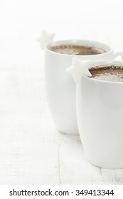 Two coffee cups on white background