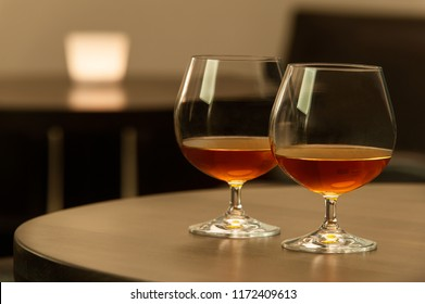 Two cognac glasses in the bar.