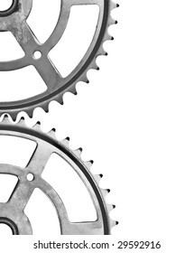 Two cogs interlocking right in the middle of the frame. Isolated on white. White space at the right.