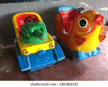 Two coin base children's fun toy ride featuring a tank and fish inside a fair