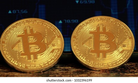 Two coin bitcoin, lying on the screen with a picture of the chart of quotations, crypto currency. Technology blockchain - 8