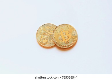 Two coins of cryptocurrency, with the two faces of the bitcoin isolated on a white background