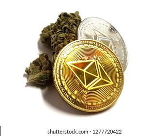 two coins gold and silver of Ethereum Cryptocurrency with Cannabis weed on isolated background, darknet concept