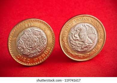Two coins on a red background