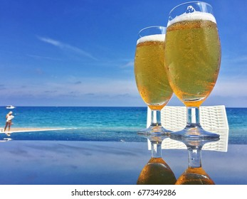 Two cold beers on the beach with a girl