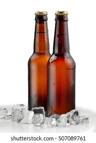 Two cold brown beer bottles with ice