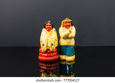 two cold looking native American salt and pepper shakers