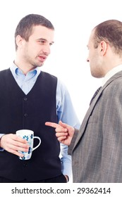 Two colleagues having a talk over coffee