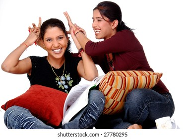 two college girls studying  over a white background