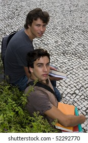 Two college or university students looking up