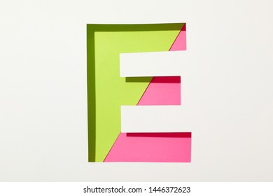 Two color letter E on white background, space for text
