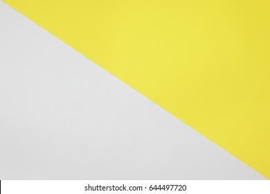 Two color paper with Yellow and white Overlap on the floor And split half of the image. background