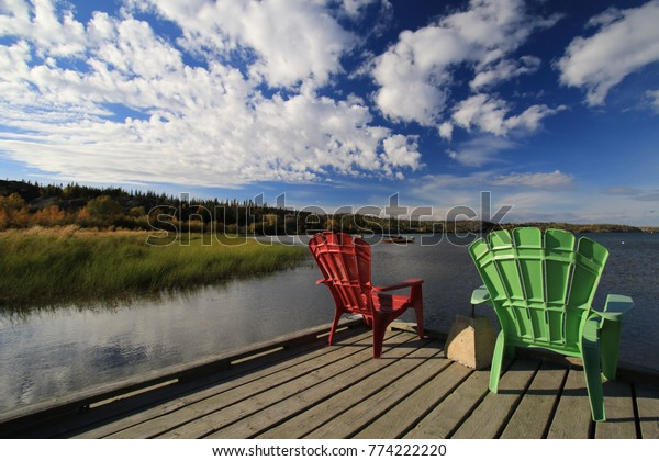 Two colored chairs at beautiful lake in Yellowknife, Northern Territories, Canada