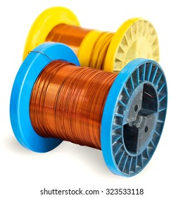 Two colored plastic spools of copper wire isolated on a white background. Blue and Yellow bright, vivid, colorful wire spools. Coil in the background is blurred.