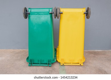 Two colorful bins with brick wall background, Green bin, Yellor bin