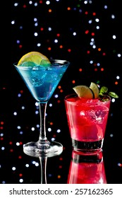 Two colorful cocktails over starry black background