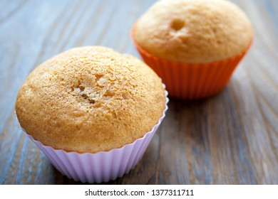 Two colorful muffins behind each other. Delicious cake for dessert.