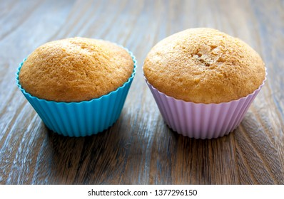 Two colorful muffins beside each other. Delicious cake for dessert.