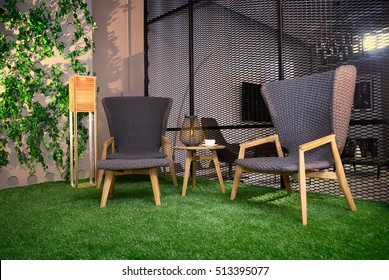 two comfortable chairs on the grass