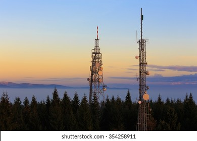Two Communication Towers with Antennas, Dusk Blue Sky, Located in The Czech Republic -  Mobile Telecommunications System