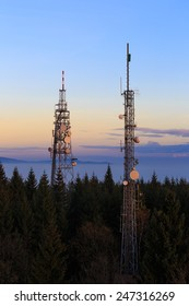 Two Communication Towers with Parabolic and GSM Antennas on Dusk Blue Sky, Located in The Czech Republic - Cerna Studnice