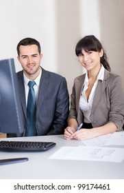Two confident business people in the office at the meeting