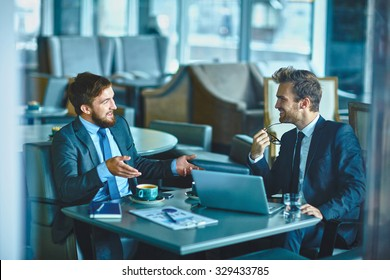 Two confident businessmen sharing their ideas and opinions