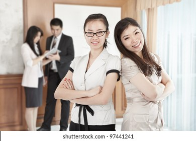Two confident businesswomen posing in the office