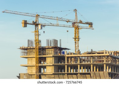 two construction crane over construction building site and blue sky background