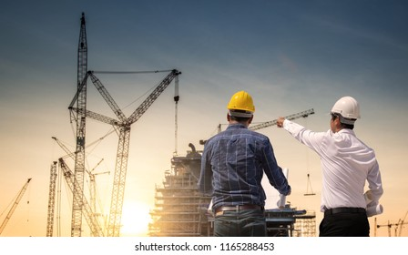 two construction engineer working in construction site and management in the construction site.
