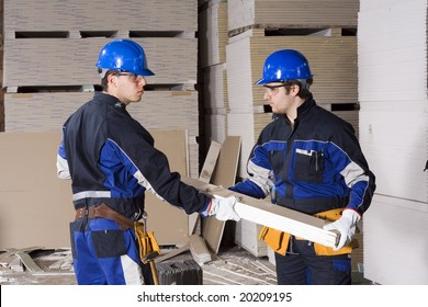 Two construction workers teamwork