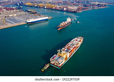 two container ship and tug boat to quayside for load and unload container via crane for logistics, import export goods internationally around the world, including Asia Pacific and Europe, by deep sea