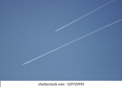 two contrails in a clear blue sky