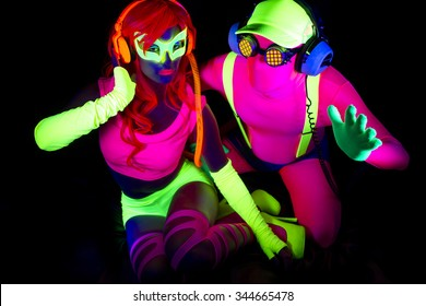 two cool disco glow characters pose in UV costume