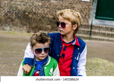 two cool kids with sunglasses looking tough
