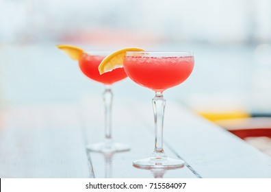 Two cosmopolitan cocktails on the table