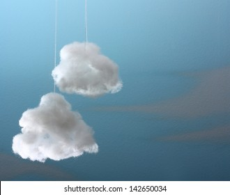 Two cotton wool cloud against blue background.